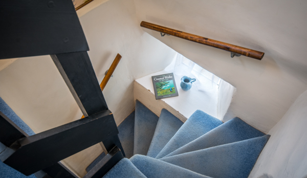 thatched romantic holiday cottage stairs