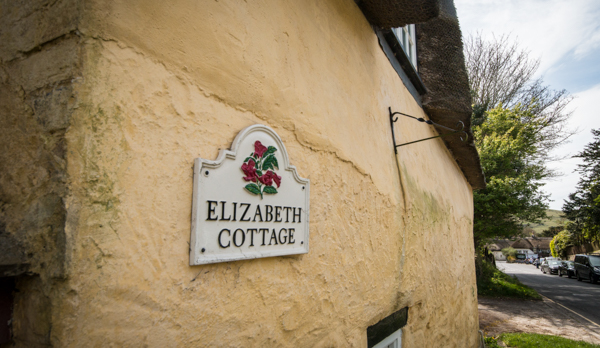 thatched romantic holiday cottage exterior sign