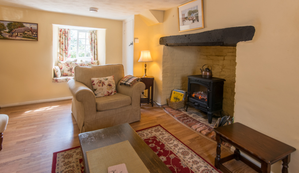 thatched romantic holiday cottage log burner
