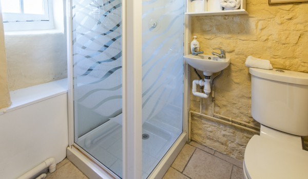 thatched romantic holiday cottage bathroom shower