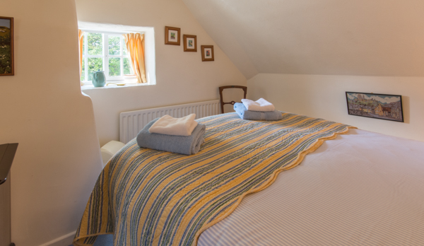 thatched romantic holiday cottage double bedroom 2 window