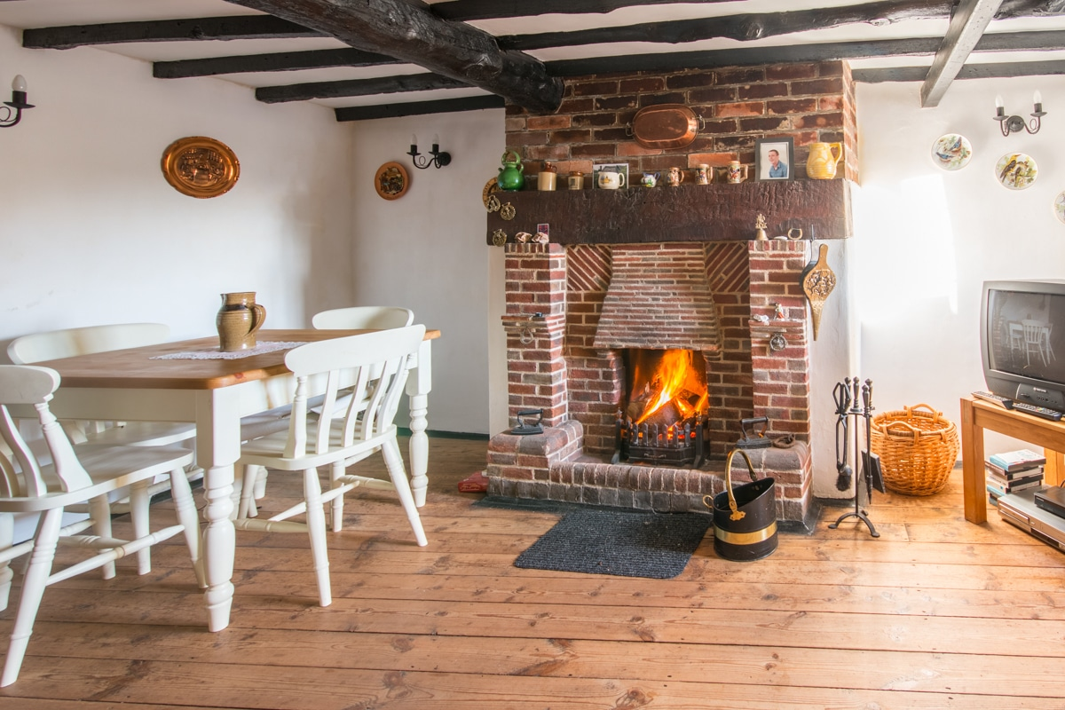 cosy thatched cottage dining room