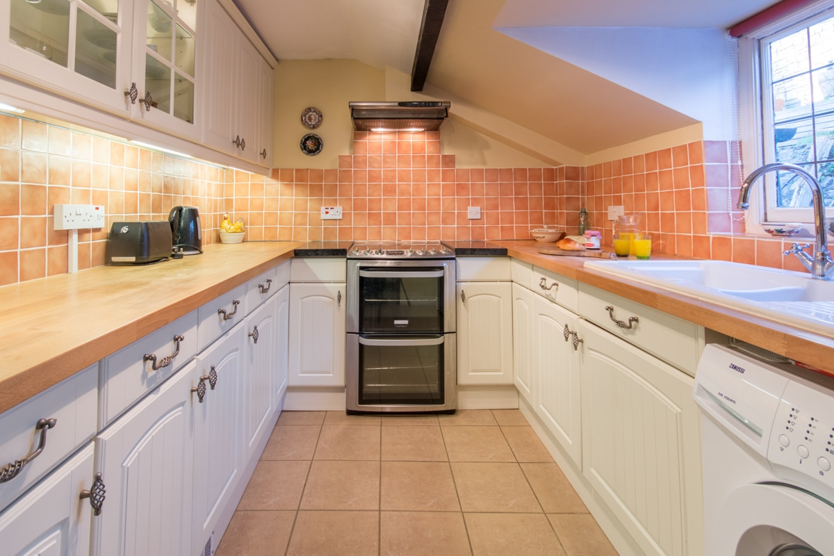 cosy thatched cottage kitchen