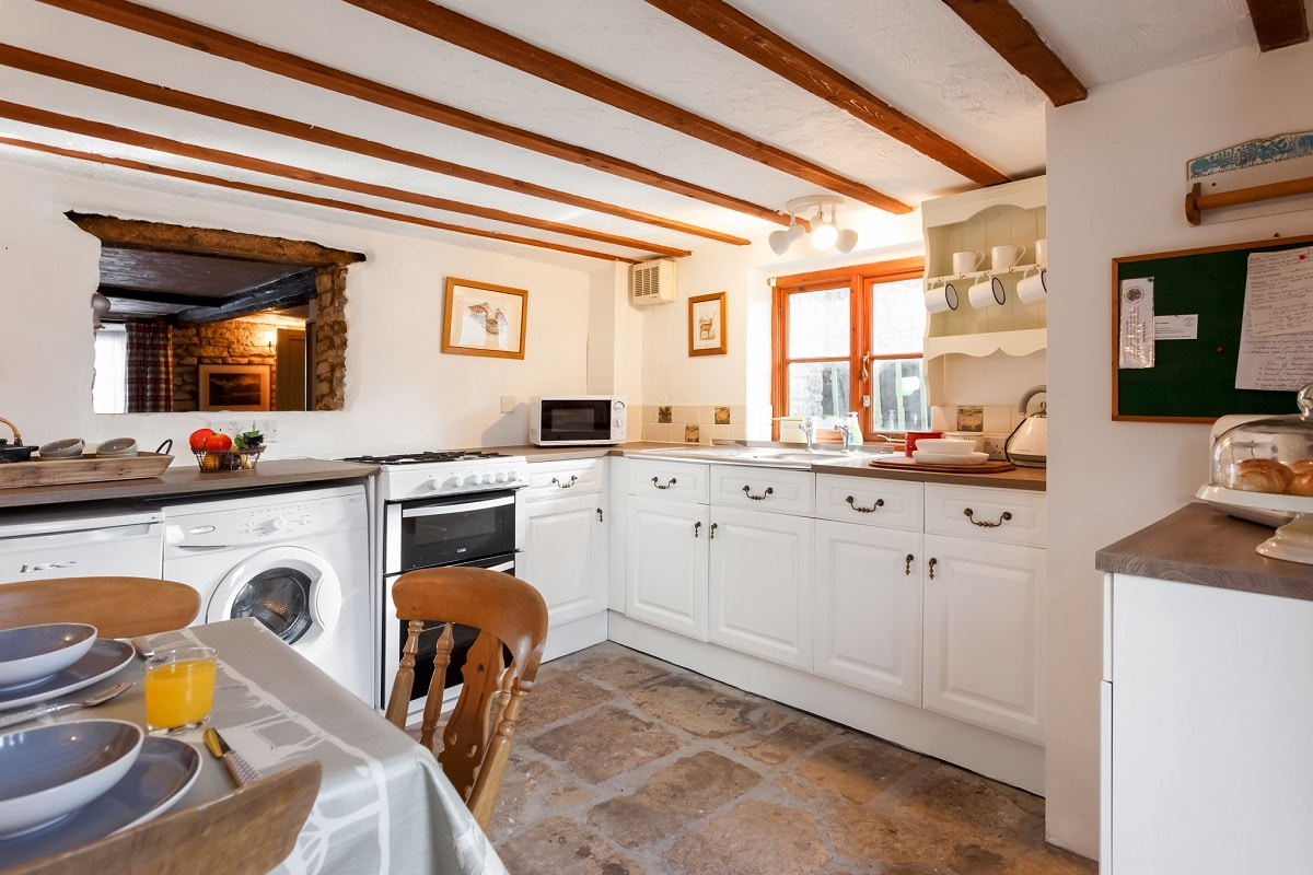 thatched cottage in corfe castle kitchen