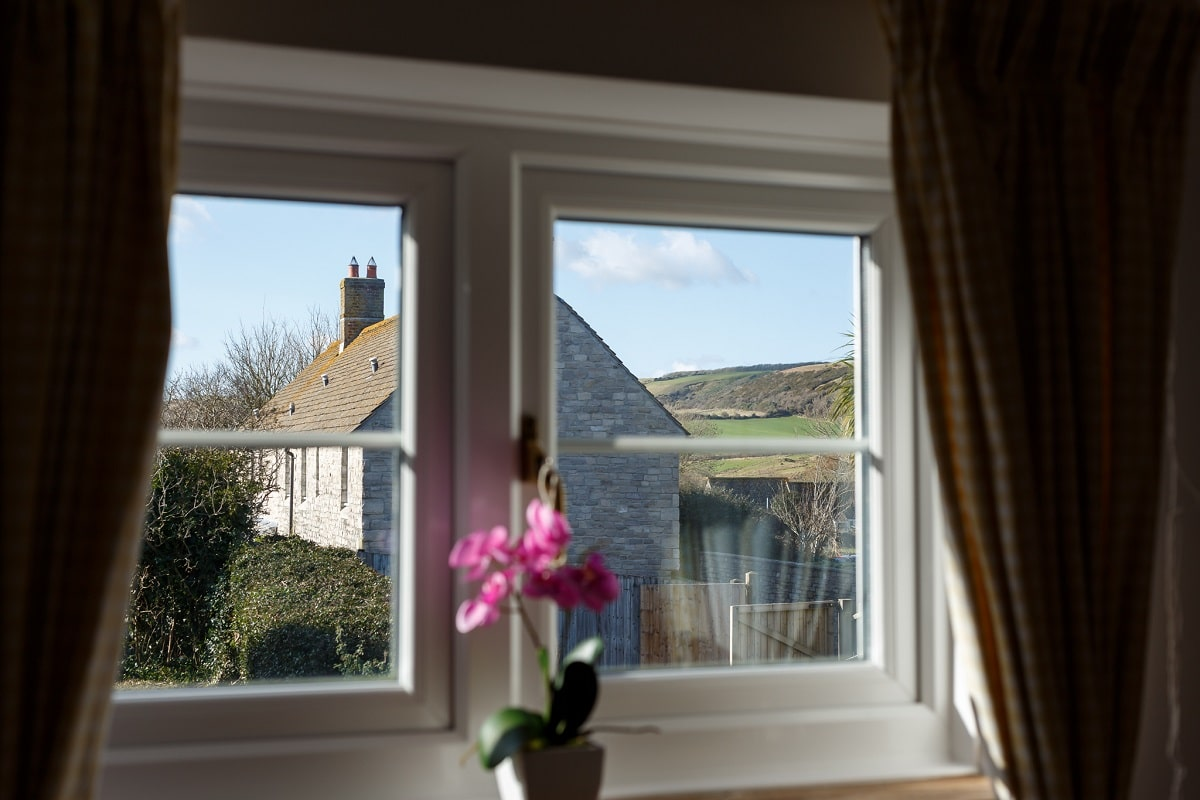 thatched cottage in corfe castle window view
