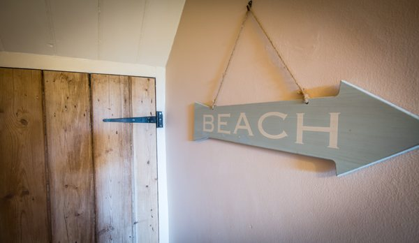 traditional purbeck holiday cottage hallway sign
