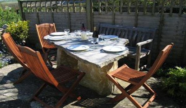 traditional purbeck holiday cottage patio dining table