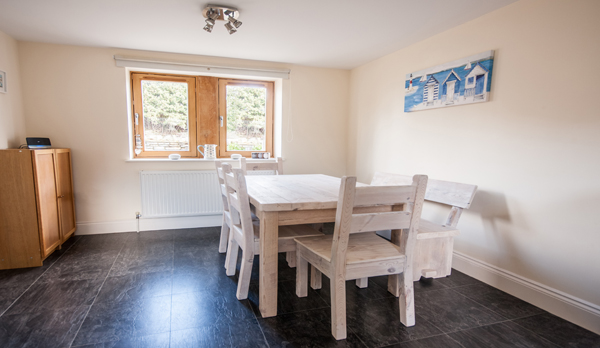 family holiday home in swanage dining table 2