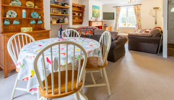holiday cottage with log burner in ridge dining area