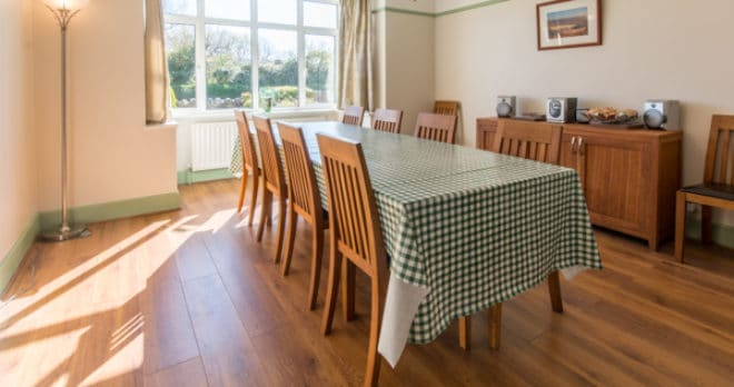 Accommodation for large groups in Swanage dining table