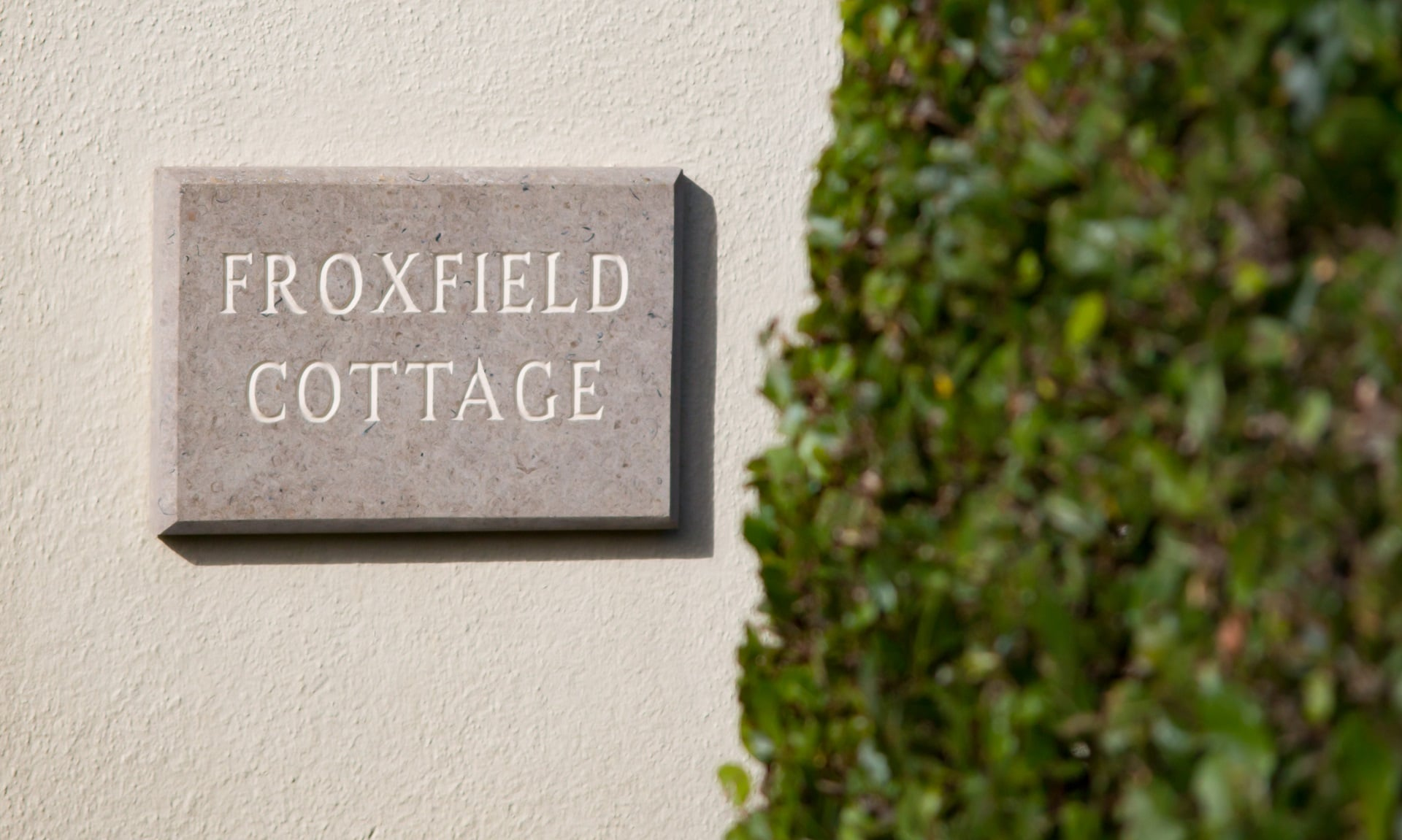 traditional purbeck holiday cottage outside sign
