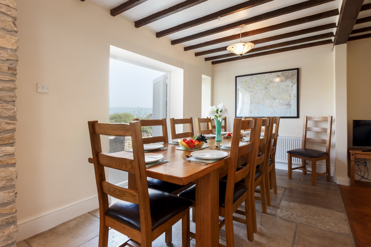 holiday home with sea views dining table